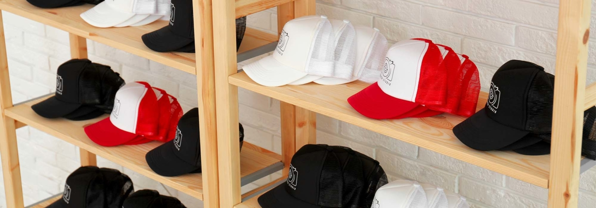 A rack of custom promotional hats